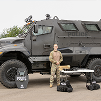 Officer Hughes w/ SWAT MRAP